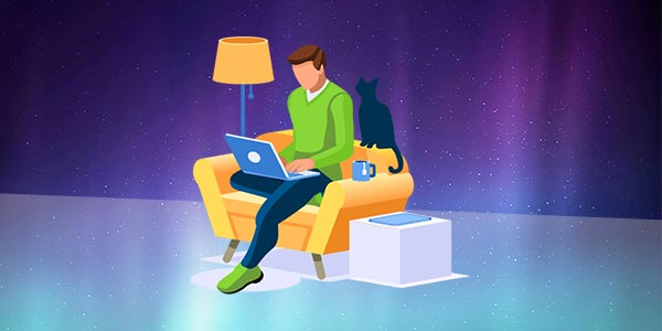 Man sitting on chair with laptop and cat