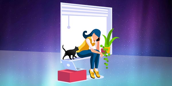 Woman sitting on windowsill with laptop and cat deep in thought